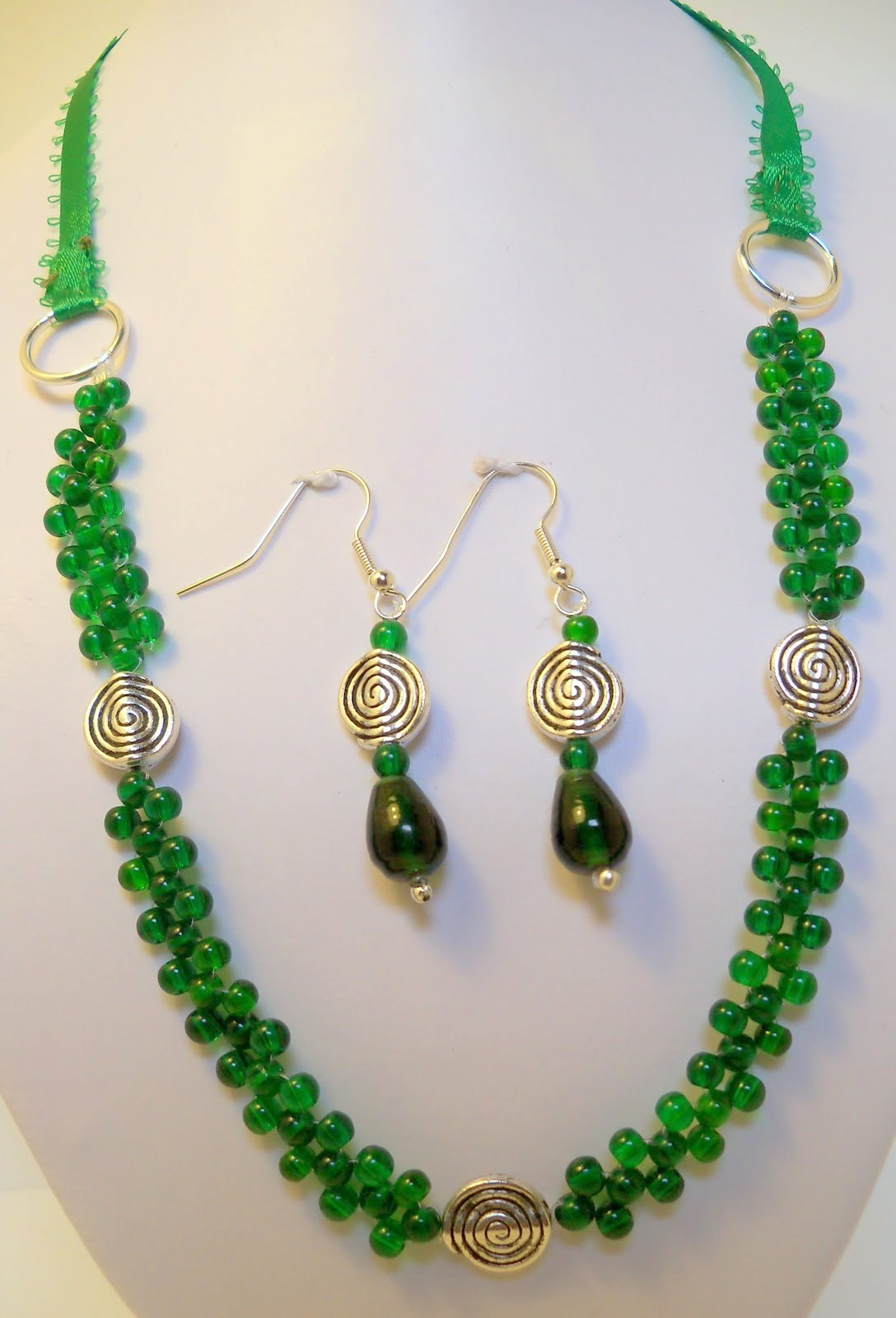 Braided green glass beads ribbon necklace and earrings